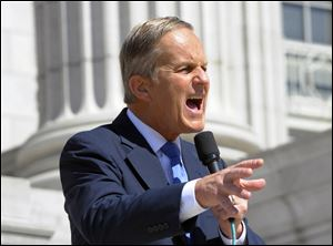 Todd Akin speaks at the Missouri Women Standing with Akin Rally on the south side steps of the Missouri Capitol on Friday.