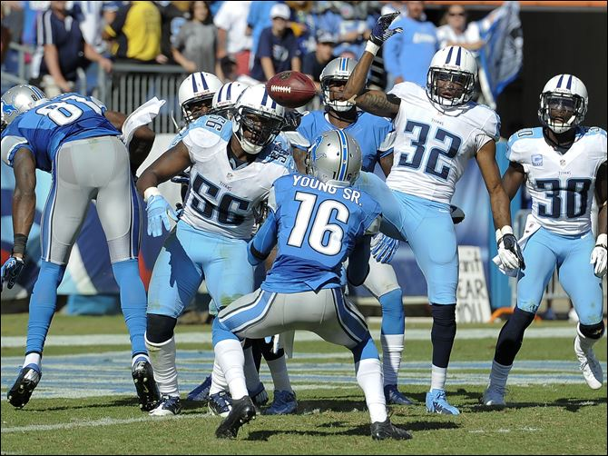 Detroit Lions wide receiver Titus Young Detroit Lions wide receiver Titus Young (16) watches the ball before catching it after a pass was tipped by players in the end zone in the final moments of the fourth quarter at an NFL football game against the Tennessee Titans.