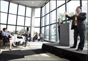 Simon Guo, the president of 5 Lakes Global, gives the keynote speech Tuesday at Fifth Third Center for the luncheon of the 5 Lakes Global International Economic Forum.