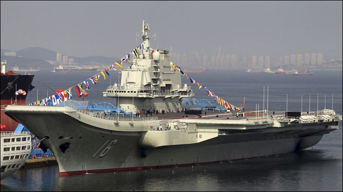 China Aircraft Carrier China's as yet unnamed aircraft carrier is decorated with colored flags at a shipyard in Dalian in northeast China's Liaoning province Monday.