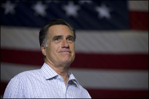 Republican presidential candidate, former Massachusetts Gov. Mitt Romney pauses during a campaign rally in Westerville, Ohio.