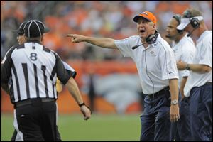 Denver Broncos head coach John Fox, right, shouts to the referee in the fourth quarter of an NFL football game against the Houston Texans, Sunday, Sept. 23, 2012, in Denver.