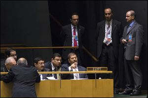 Egyptian President Mohamed Morsi sits with his delegation before addressing the 67th United Nations General Assembly, at U.N. headquarters Wednesday