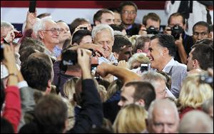 Republican Presidential candidate Mitt Romney greets supporters Wednesday, at the SeaGate Centre.