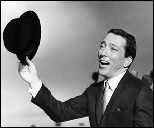 Andy Williams performs a song on a television show in May, 1961. Emmy-winning TV host and