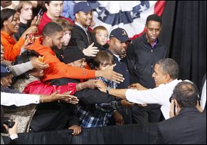 President Barack Obama campaigns Wednesday at the Bowling Green State University Stroh Center.