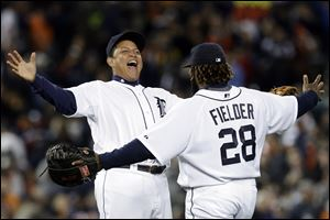 Detroit Tigers' Miguel Cabrera, left, and Prince Fielder (28) celebrate their 5-4 win over the Kansas City Royals in a baseball game in Detroit on Wednesday.
