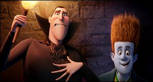 Dracula, voiced by Adam Sandler, left, and Johnnystein, voiced by Andy Samberg in a scene from
