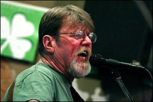 Singer Pat Lewandowski performing at Mickey Finn's in Toledo, Ohio on St. Patrick's Day.