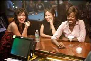 Maggie Gyllenhaal, left, Rosie Perez and Viola Davis, right, in a scene from