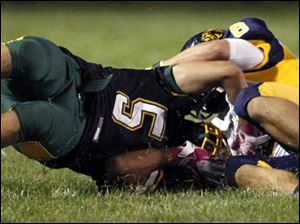 Clay's Anthony Ramirez (5) collides with Whitmer's Matthew Sutter (8).