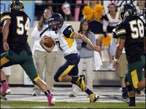 Whitmer QB Nick Holley (7) runs the ball.