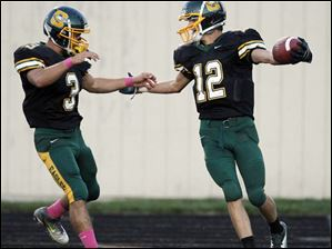 Clay's Kyle Row (12) celebrates scoring a touchdown with Devin Dominique (3).
