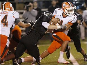 Southview senior quarterback Austin Valdez attempts to break through the Perrysburg line.