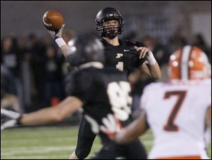 Perrysburg's senior quarterback Steve Slocum looks for an opening.
