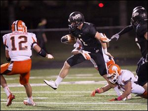 Perrysburg's senior quarterback Steve Slocum breaks away from Southview defenders.