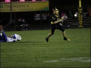 Kyle Kremchek, of the Northview Wildcats, prepares to throw the ball.