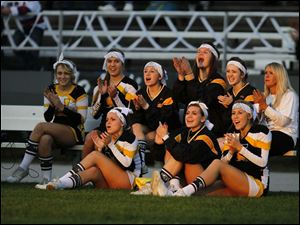 Cheerleaders for the Northview Wildcats applaud for seniors as they are named off during senior night.