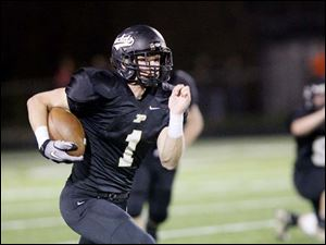 Perrysburg's senior quarterback Steve Slocum runs in a touchdown.