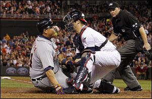 Tigers' Miguel Cabrera is tagged out at home plate by Minnesota Twins catcher Joe Mauer on Friday night in Minneapolis.