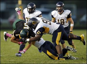 Clay's Anthony Ramirez (5) collides with  Whitmer's Marquise Moore (91).