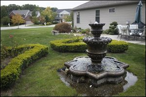 Maumee residents Garry and Carol Mulkey have used their quarter-acre yard to create several water features, including a fountain. In addition to a number of other plantings.