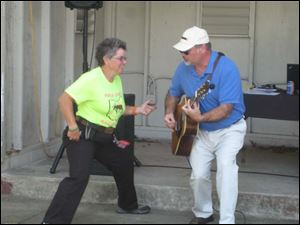 Beth Meyer and Matt Meeker provided live entertainment at the Toledo Ski Club Pig Roast to benefit Meyer, who is in the special olympics in February.