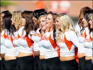 Bowling Green State University dance team members stand for the alma mater before the game.
