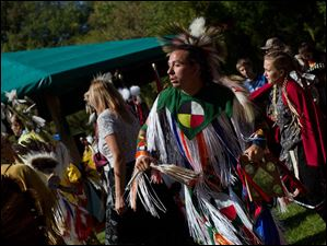 Jarrod Craft, of Ashville, center, participated in an intertribal dance to honor the drums. Craft, who is Shawnee, also danced the Grass Dance.