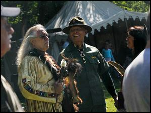 Head Warrior Corky Knox, of Ypsilanti, center right, talks with other native attendees. Knox, who is a member of the Pequat and Tlingit tribes, was honored, along with other veterans, during the ceremony.