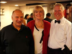 Mike Ault, left, poses with Donna and Dave Brown, a past president of the Toledo Ski Club.