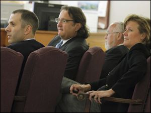 From left: defendants Tony Packo III and Cathleen Dooley, with attorneys Mark Jacobs