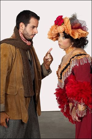 Lee Poulis, left, as Marcello and Jennifer Rowley as Muscetta in 'La Boheme.'
