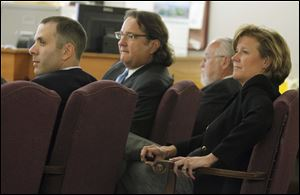 From left: defendants Tony Packo III and Cathleen Dooley, with attorneys Mark Jacobs and Rick Kerger, during the Packo criminal trial Friday.