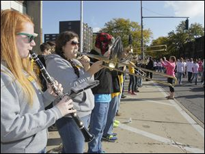 Northview High School Marching Band members Megan Lorenz, a senior, and Janelle Fowler, also a senior, playing for the marchers.