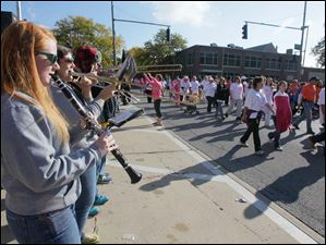 Northview High School marching band members members Megan Lorenz, a senior, and Janelle Fowler, also a senior, playing for the marchers.