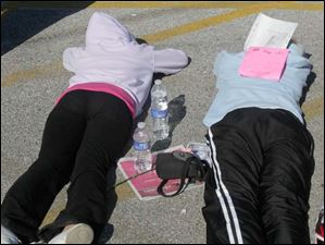 Races take a break following the Komen Northwest Ohio Race for the Cure, in Toledo.