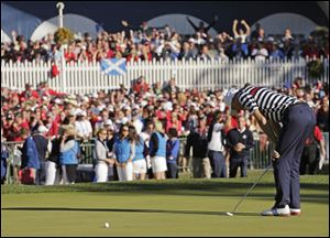 USA's Jim Furyk reacts after missing a putt on the 18th hole and losing to Europe's Sergio Garcia during a singles match at the Ryder Cup PGA golf tournament Sunday.