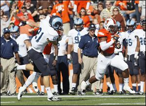 Bowling Green's BooBoo Gates gets a block from a teammate on Rhode Island punter Tim Wienclaw on an 80-yard punt return for a touchdown in the first quarter.