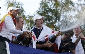 Europe's Sergio Garcia, left to right, Luke Donald and  Justin Rose celebrate after winning the Ryder Cup PGA golf tournament Sunday, at the Medinah Country Club in Medinah, Ill.