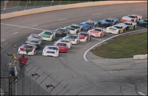 The 24th running of the Great Lakes Helicopter Glass City 200 at the Toledo Speedway gets under way.