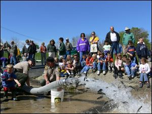 Earlier this year, students from the Vermilion area watched as Division of Wildlife personnel stocked yearling steelhead trout produced at the Castalia State Fish Hatchery into the Vermilion river.