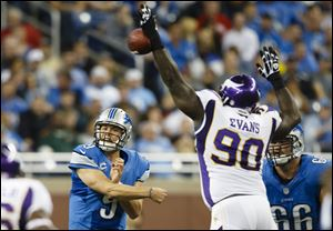 Minnesota Vikings nose tackle Fred Evans (90) blocks a pass by Detroit Lions quarterback Matthew Stafford (9) during the second half at Ford Field in Detroit on Sunday.