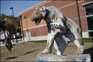 The statue of Woodward's polar bear mascot, Polaris, has become weathered after exposure to the elements since it was built in 1978.