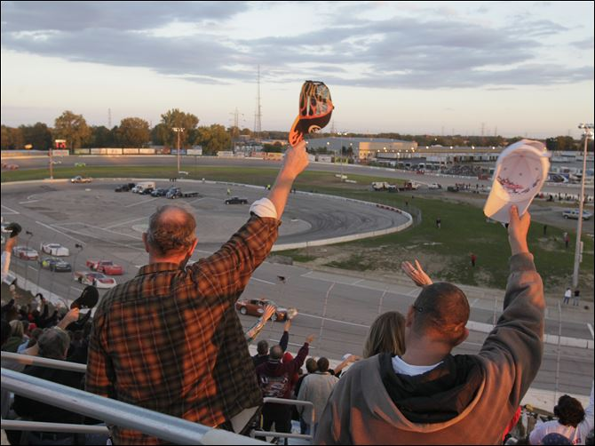 Glass City 200 fans Fans raise their hats to the drivers at the start of Saturday night's race at Toledo Speedway. The fans in attendance were treated to a wild finish.