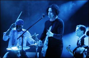 Jack White, center, performs at Lollapalooza in Chicago's Grant Park on Sunday, Aug. 5.