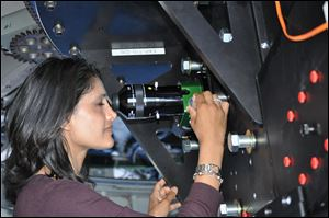 Dr. Rupali Chandar, associate professor of astronomy. At Venus looking through a special commemorative eye piece at the Discovery Channel Telescope outside Flagstaff, Ariz.