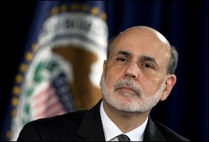 Federal Reserve Chairman Ben Bernanke, shown at an earlier event, offered a sharp defense today of the Federal Reserve's bold policies to stimulate the weak economy.