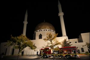 Firefighter work to find the source of reported smoke at the Islamic Center in Perrysburg on Sunday.