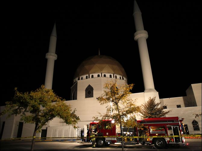 Islamic center of greater toledo Firefighter work to find the source of reported smoke at the Islamic Center in Perrysburg on Sunday.
